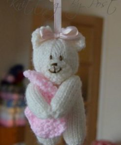 small bear pram charm knitting pattern in cream and pink