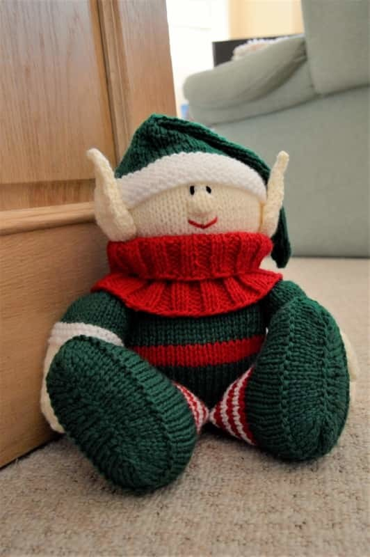 elf knitting pattern doorstop sitting with stripes green and red body
