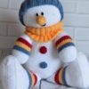 snowman softie knitting pattern sitting with stripes and hat