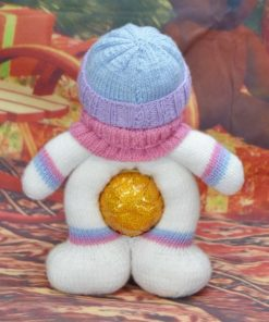 back of chocolate orange santa soft toy in blue pink and lilac