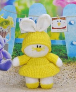 bunny rabbit knitting pattern in yellw with hat and dress and big ears