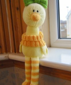 duck sat on a shelf knitting pattern in yellow and orange