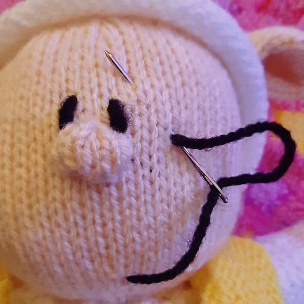 attach eyes to a knitted toy 7